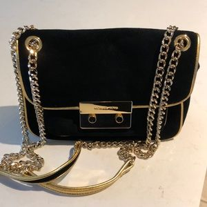 Like new Micheal Kors suede tote on a chain